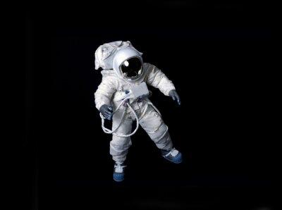 Plakát Astronaut plovoucí na černém pozadí.