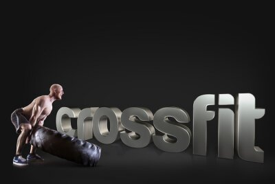 Plakát Athletic mladý muž zvedání pneumatiku na černém pozadí Motivační fitness frází