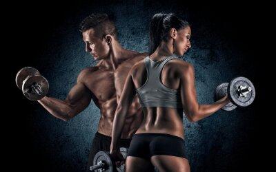 Plakát Atletický muž a žena s činky.