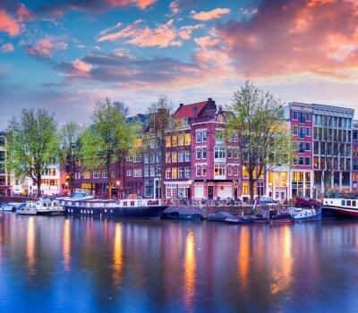 Plakát Barevné jaro západ slunce na kanálech Amsterdamu