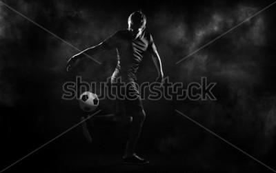 Plakát bright soccer playerl on the black background