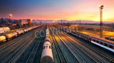 Plakát Cargo freigt train railroad station at dusk