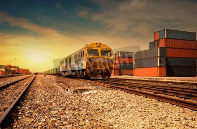 Plakát Cargo train platform at sunset with container