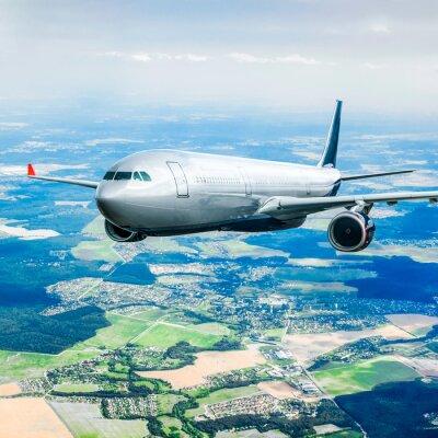 Plakát Cestující letadlo na obloze
