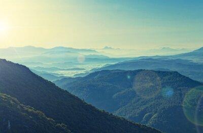 Plakát cross zpracované pohled na východ slunce nad pohořím
