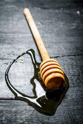 Plakát Dřevěná lžíce sladké přírodního medu.
