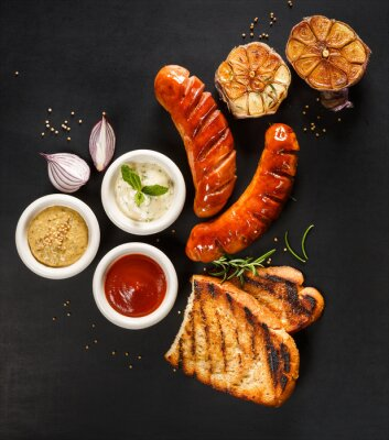 Plakát Grilled sausages with different types of dips