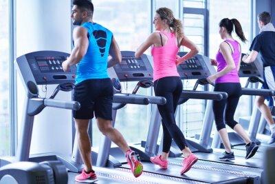 Plakát Group of people running on treadmills