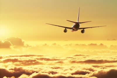 Plakát Letadlo na obloze při západu slunce