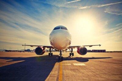 Plakát Letadlo při východu slunce