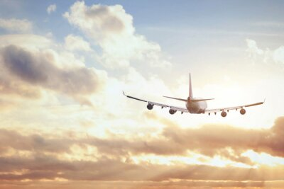 Plakát letadlo v obloze slunce