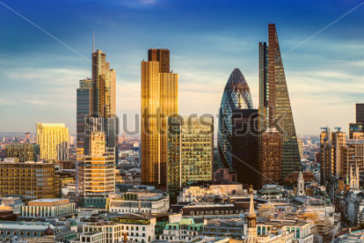 Plakát London, England - Business district with famous skyscrapers and landmarks at golden hour
