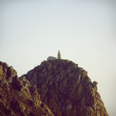 Plakát Maják na vrcholu kamenného útesu