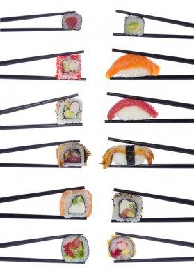 Plakát Many sushi rolls in chopsticks isolated on white background