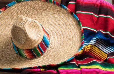 Plakát Mexican Sobrero and Serape blanket on yellow background with cop