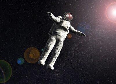 Plakát plovoucí astronaut ve vesmíru se sluncem