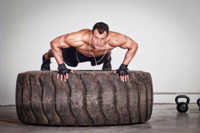 Plakát Push up on a tire crossfit training