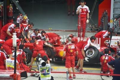 Plakát Sepang F1 Circuit, Malaysia - April 2, 2010 - The crew of Scuderia Ferrari Marlboro F1 racing team practicing tyres change during Petronas Malaysian Grand Prix 2010 April 2-4, Sepang.