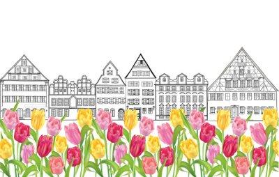 Plakát Staré budovy a domy v Amsterdamu s květinou tulipány uličky.