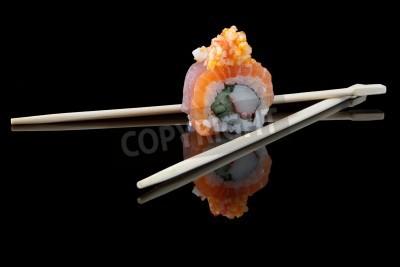 Plakát sushi with chopsticks over black background