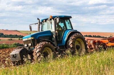 Plakát Tractor on the field
