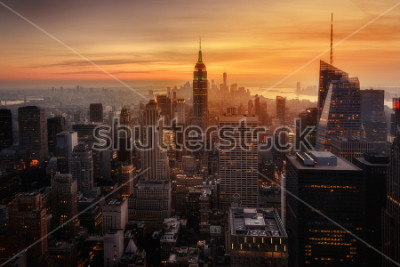 Plakát View of New York City from the top of one of its viewpoints, capturing the warm light of sunset