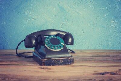 Plakát Vintage telefon na dřevěném stole