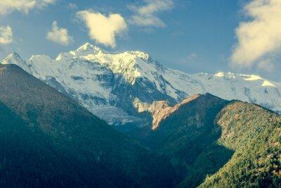 Plakát Vrchol hory pokryté mraky.