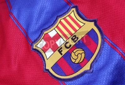 Plakát Barcelona, Španělsko - 28.ledna 2012: Crest of Barcelona fotbalového klubu na na oficiálních dres. FC Barcelona byla založena v 1899.